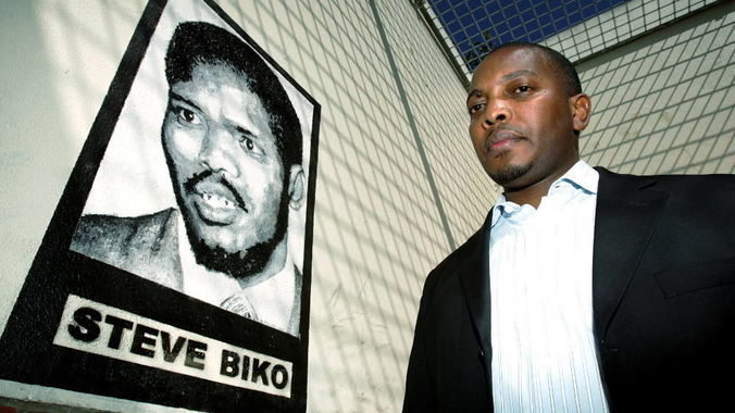 Picture of Nkosinathi Biko besides his father courtesy of Mail and Guardian. Listen to the conversation below:
